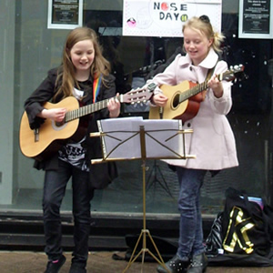 Students of Chris Stevens busking on the streets of Chester